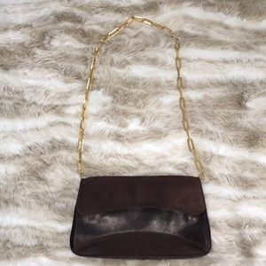 Brown leather and suede gold chain purse.